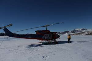 Loading coolers of ice onto the helicopter. Photo: Nels