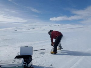 Nels cutting tephra-bearing ice with a chainsaw. Photo: Meghan Seifert