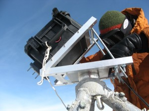 Mounting the camera on its tripod at the crater rim