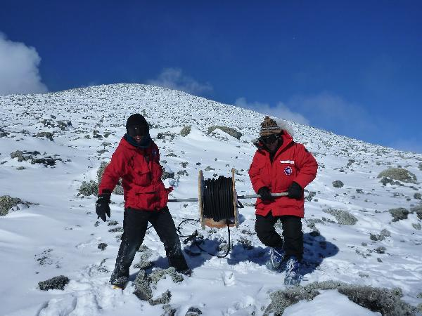 Laying Cable: Aaron and Kevin spooling the new power cable out from the crater rim. We ended up using 8 of these drums to get from the crater down to Nausea Knob where the batteries and solar panels are. Each drum weighed 95 lbs!