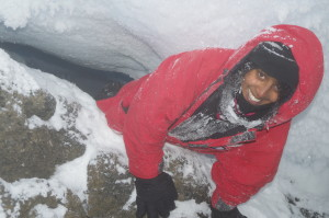 Crawling around an ice cave in search of a good sampling location